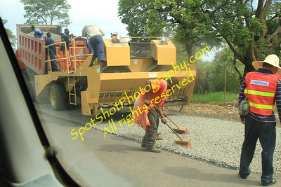 Road Construction Crew. Note the brooms!